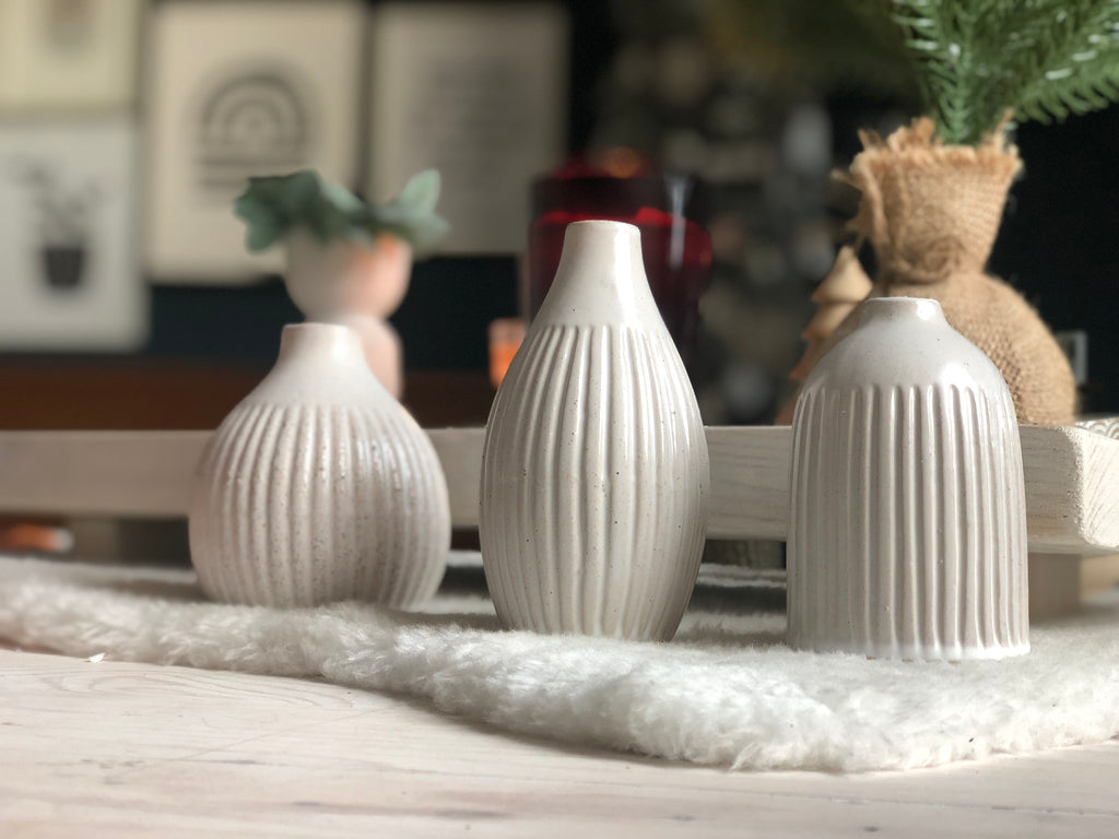 Trio of grooved ceramic vases