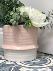 pink artisan pot with eucalyptus & white florals