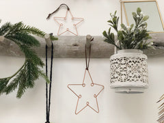 2 copper star decorations