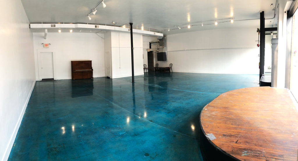 1500 square foot room with turquoise epoxy flooring.