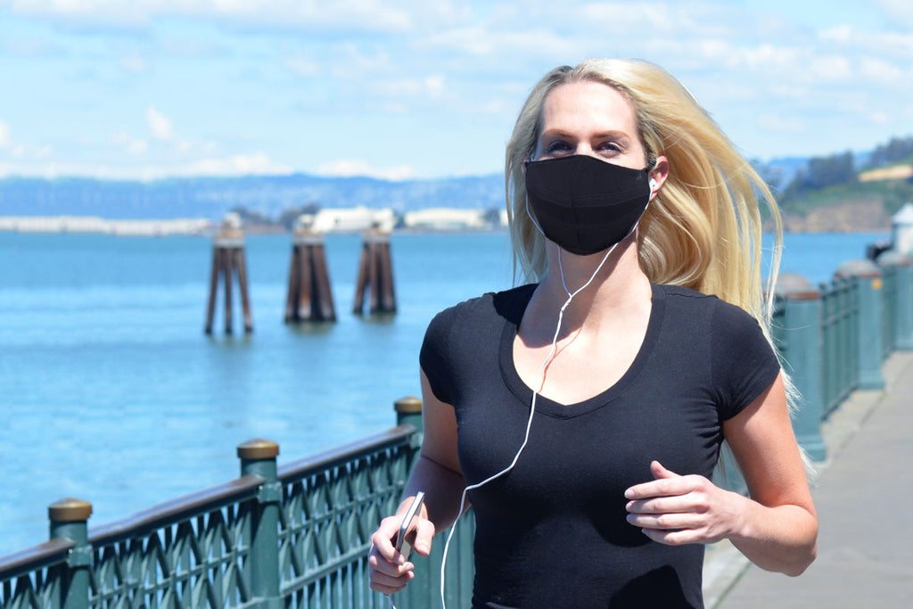woman running wearing a face mask