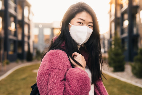 college undergraduate student wearing white ora mask going back to school