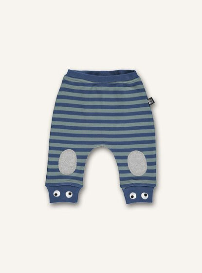 UBANG baby pants with blue stripes. They have extra padding at the knees and small eyes at the bottom of the legs. The pants have an elasticated waist.