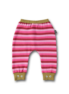 UBANG baby pants with pink stripes. They have an elasticated waist and embroided eyes at the bottom of the legs.