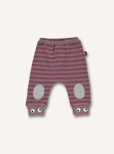 Ubang striped pants for babies in the colour woodrose. They have padding on the knees and small eyes embroided at the bottom of the legs.