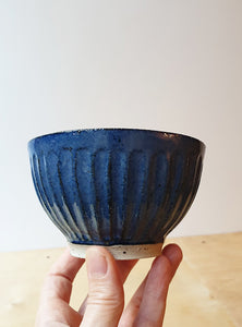 Hand thrown blue bowl with carvings - SOLD