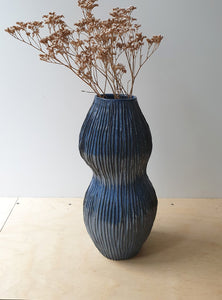 Organic shaped hand built blue vase