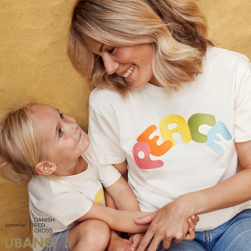 Peace t-shirt by UBANG worn by mother and daughter.