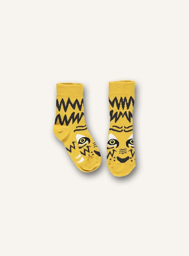 UBANG socks with a tiger design. The socks are yellow and black.