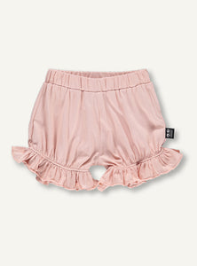 UBANG organic bloomers in a baby pink for babies. The bloomers have soft elastic by the waist and legs