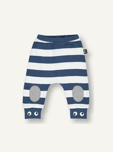UBANG baby pants with white and blue stripes. They have grey padding on the knees and small eyes embroidered at the bottom of the legs.
