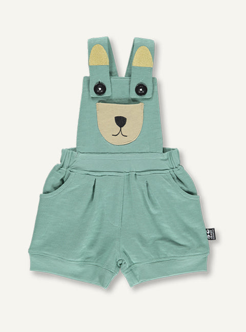 UBANG overalls in moss green. They are short an have a embroided bear at the front.