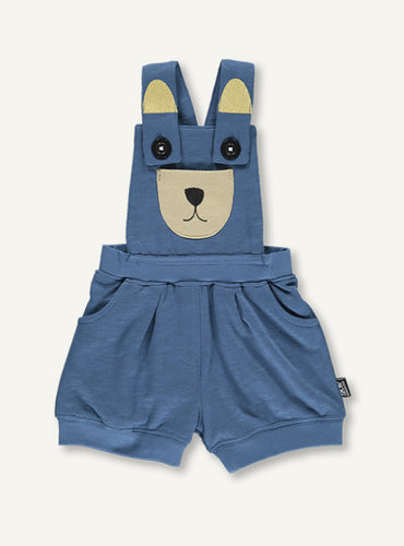 UBANG overalls for babies in blue. They are short and has a bear embroided at the front.