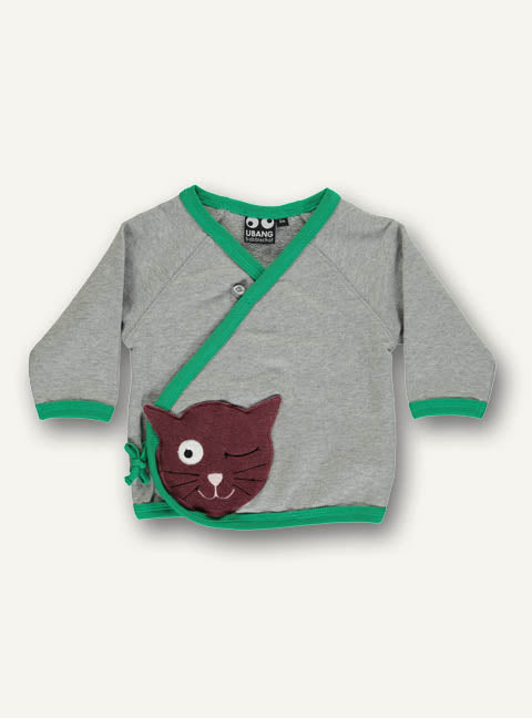 UBANG baby wrap sweatshirt. It is grey with green details and a brown cat appliqué at the bottom. The sweatshirt has a wrap design and closes with small ribbons.