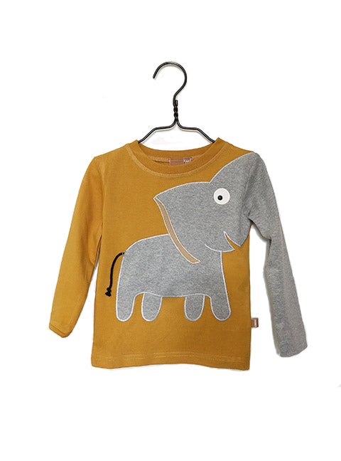UBANG long sleeved t-shirt in mustard yellow. It has an elephant on the front where the trunk turns into one sleeve.