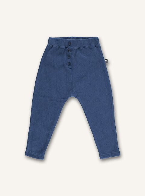 UBANG harem pants in dark blue. They have an elasticated waist and bottoms down the front.