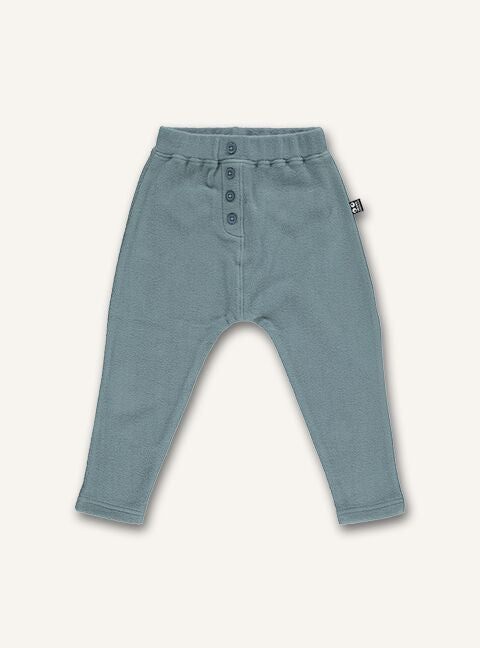 UBANG harem pants in the colour slate. They have an elasticated waist and bottoms on the front.
