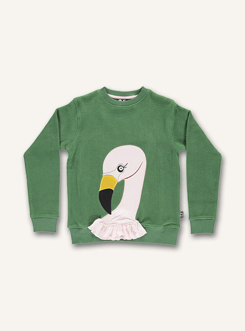 UBANG long-sleeved t-shirt in hedge green with an flamingo appliqué. It has frills at the bottom of the shirt.