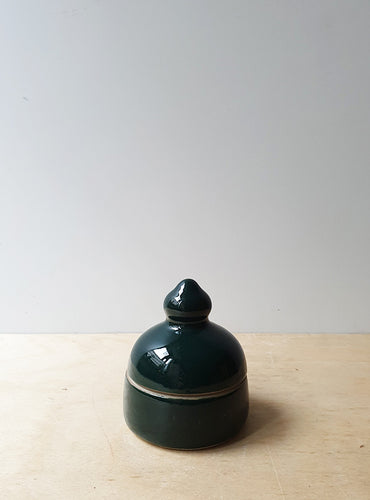 Dark green lidded jar