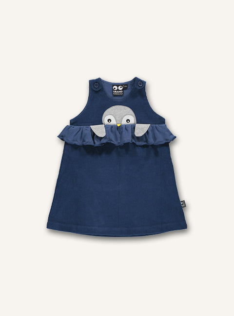 UBANG baby dress in dark blue. It has a penguin embroidered on the front and ruffle detailing.