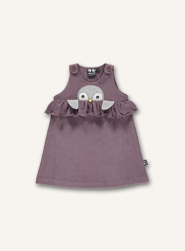 UBANG baby dress with embroidered penguin on the front. This is a beautiful dusty rose colour and it has ruffle detailing at the waist.