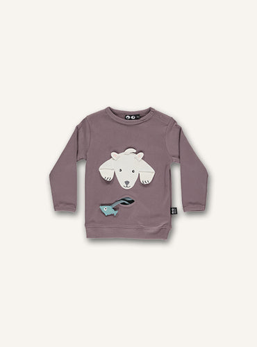 UBANG baby t-shirt with long sleeves in the colour woodrose. It has a polar bear on the stomach and a small pocket with a fish.