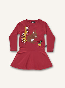UBANG long-sleeved red dress with a squirrel appliqué. The dress has a small pocket at the front with an acorn attached at the bottom of the pocket.