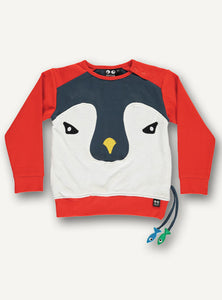 UBANG penguin t-shirt with long-sleeves. It is red and has a penguin face on the front. It features a side pocket with small fish attached to it.