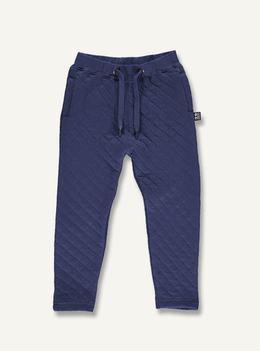 UBANG quilted pants in dark blue. They have a drawstring at the waist for the perfect fit.
