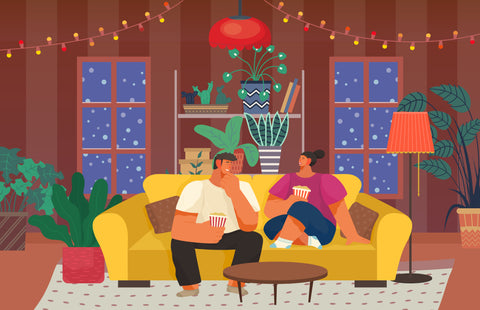 Couple on living room couch during winter