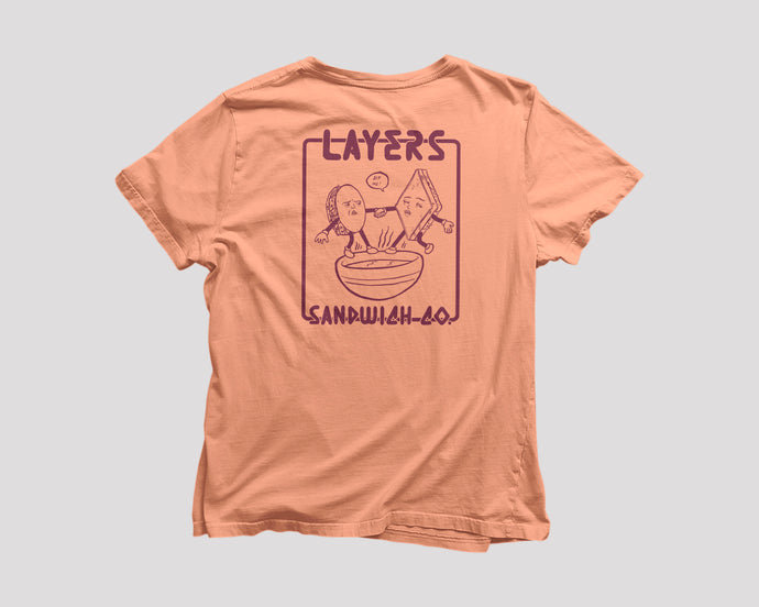 Peach t-shirt with dancing sandwiches on the back