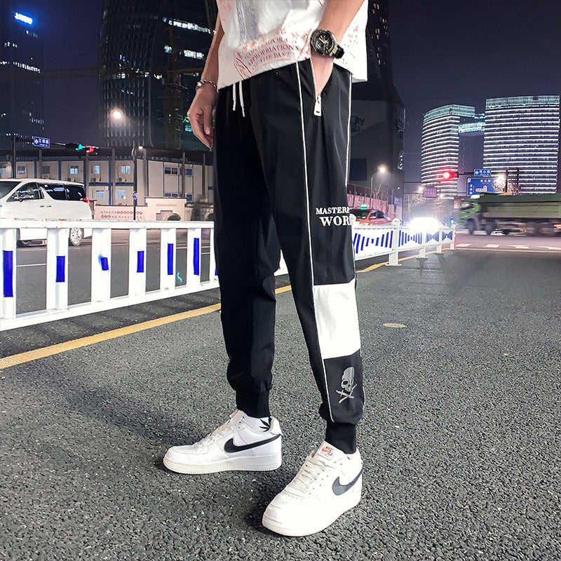Skull print glow-in-the-dark athletic casual joggers