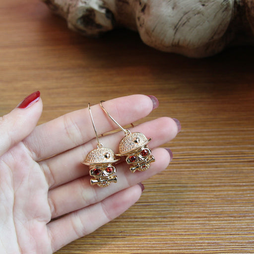 Skull studs and diamond earrings