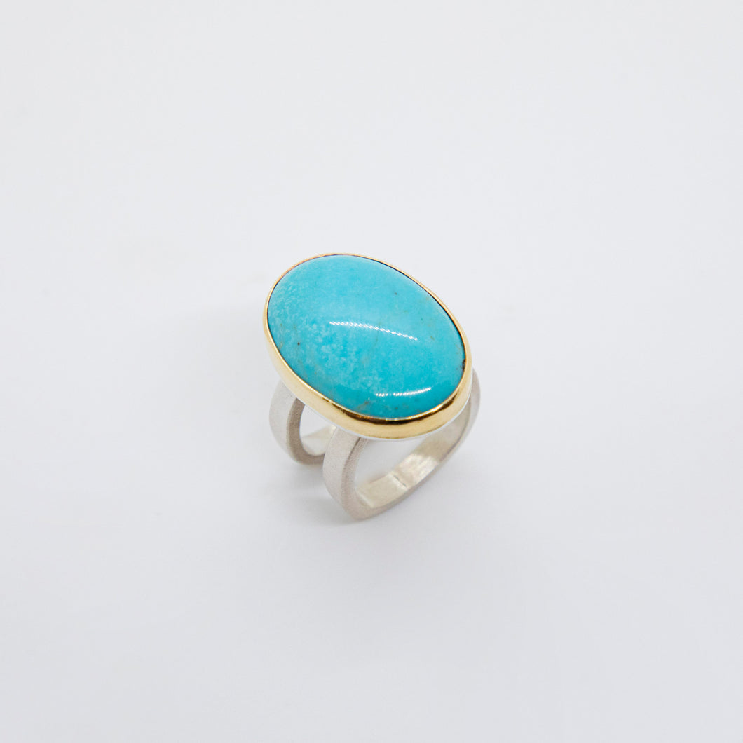 LARGE OVAL TURQUOISE, STERLING SILVER AND 18K GOLD RING