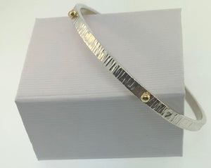 STERLING SILVER AND 18K YELLOW GOLD BANGLE