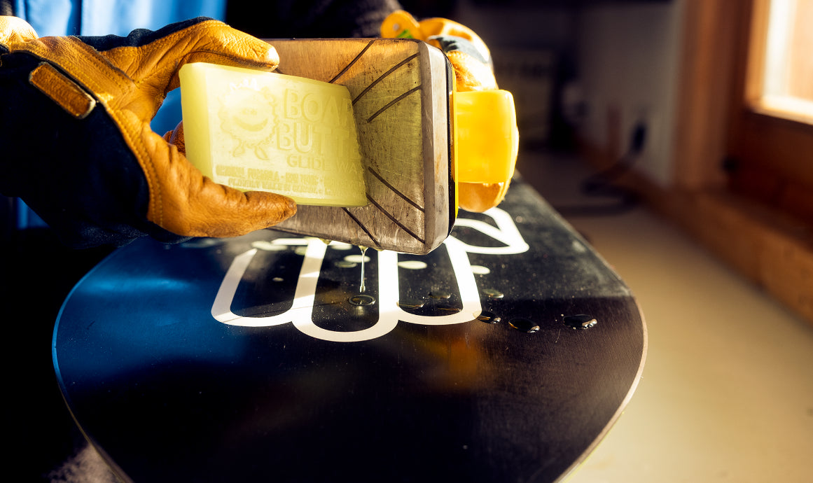 snowboard waxing with a hot iron