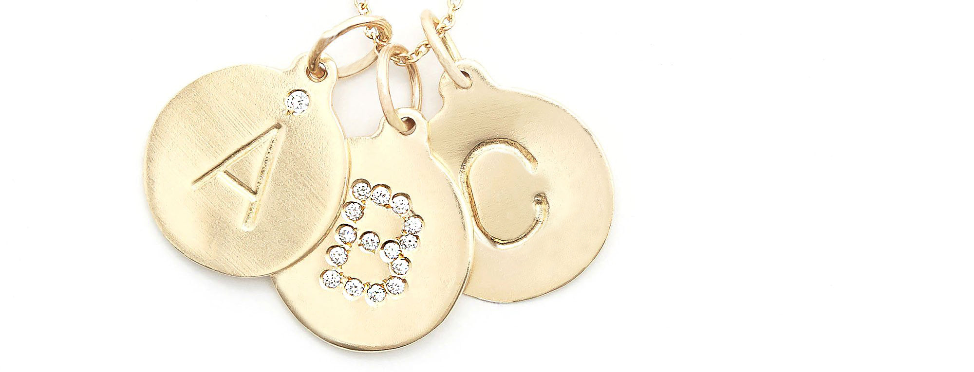 Alphabet charms for necklaces and bracelets. Solid 14k gold with diamond accents. Shop now.