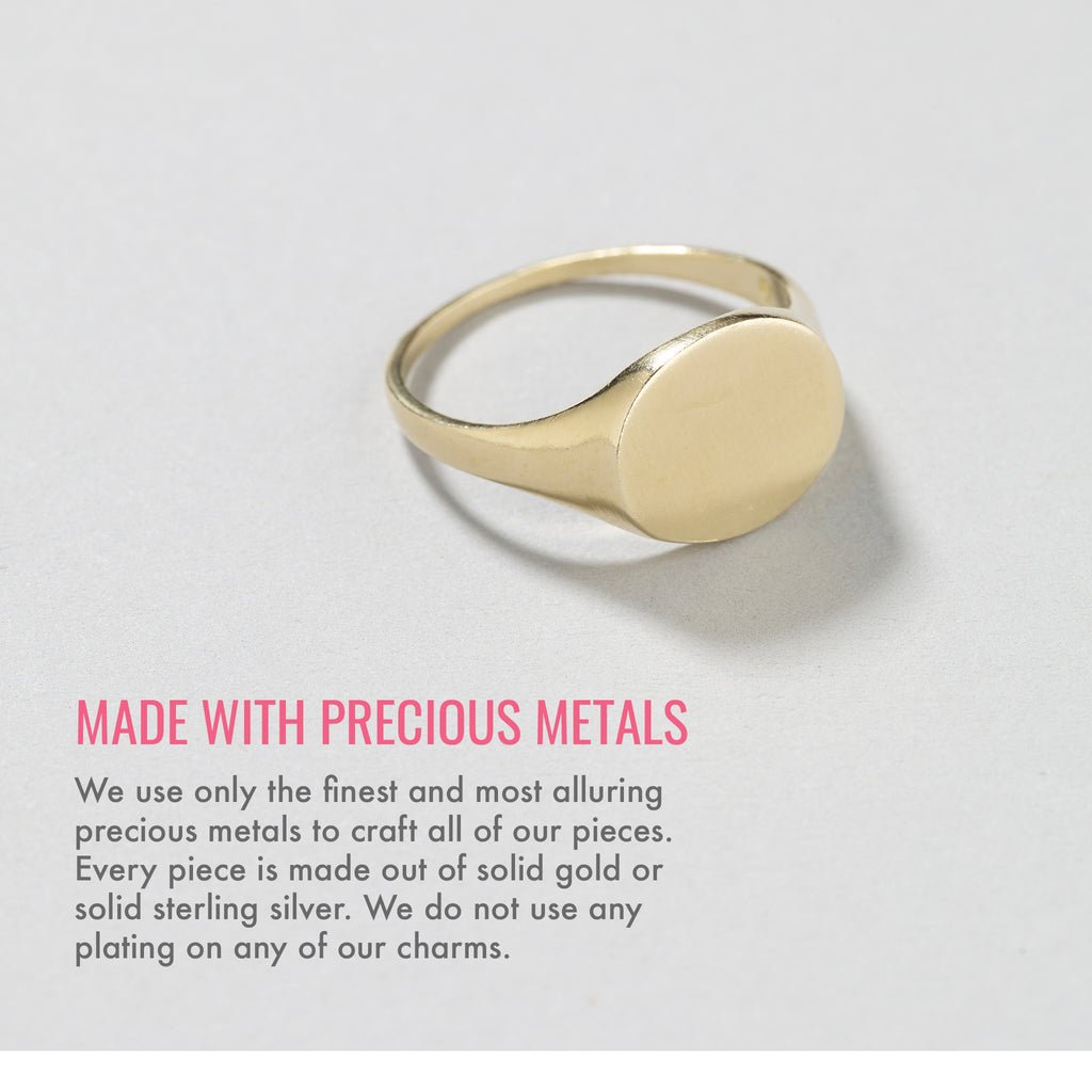 Made with precious metals. We use only the finest and most alluring precious metals to craft all of our pieces. Every piece is made out of solid gold or solid sterling silver. We do not use any plating on any of our charms.