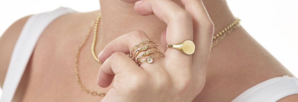 The chain rings come in three unique variations; the plain chain ring, the chain ring with circle diamond and the chain ring with oval diamond. These golden rings can be make a statement worn alone or can stacked up for that extra dazzle!  Helen Ficalora's rings make the best gift for everyone. Surprise your loved one, or express love with our small yet significant chain rings!