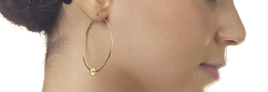 Our favorite new addition to our earrings collection are these big, beautiful and delicate golden hoop earrings with diamond disks. These are one of a kind pair of hoops that will go with everyone's style and bling up any outfit.