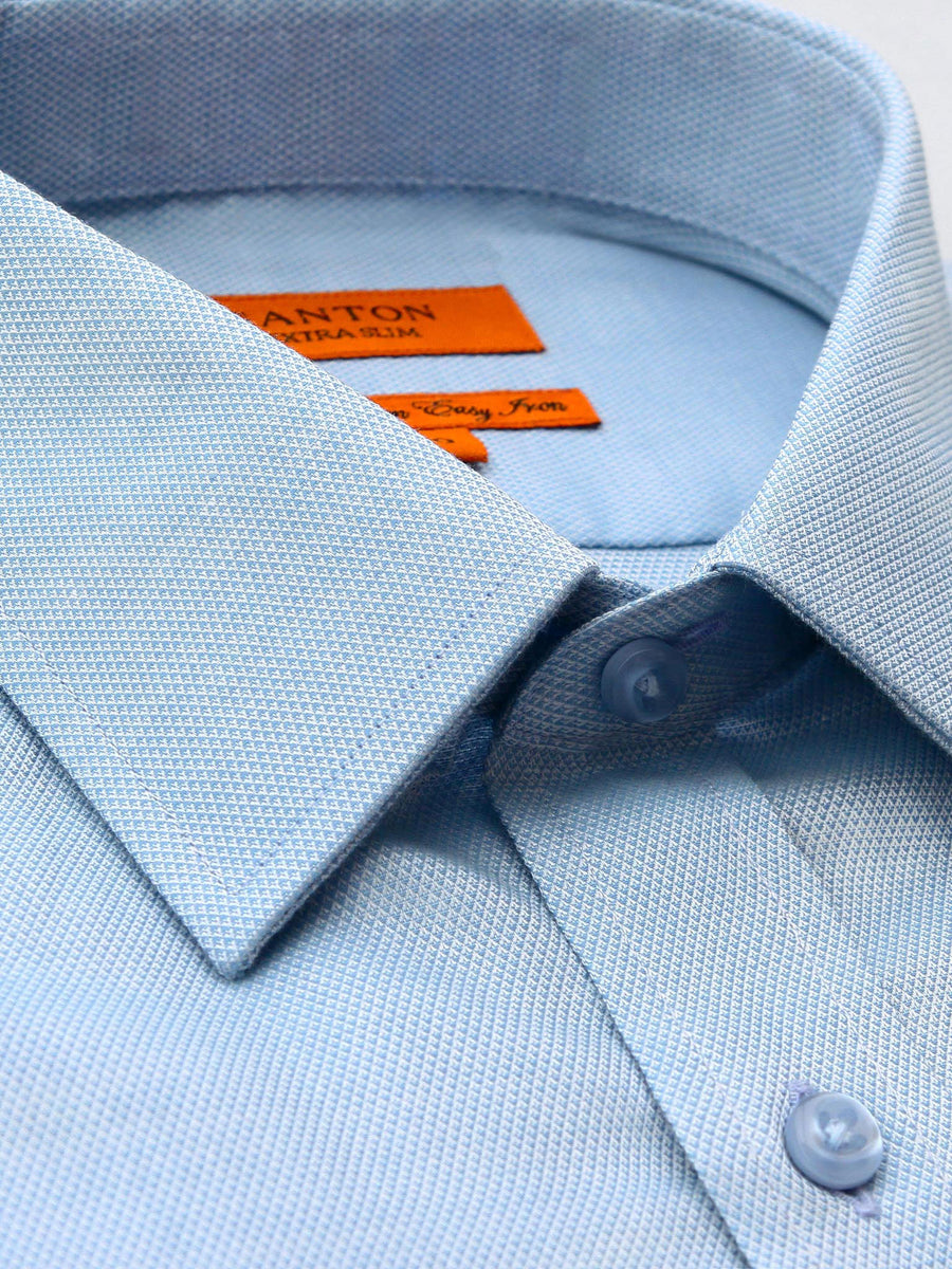 Aaron textured blue shirt in a Ganton slim fit with spread collar and button cuff.