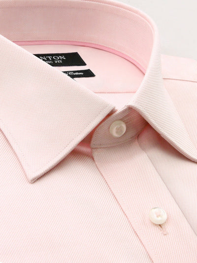 Pink Oxford shirt that features a spread collar and placket