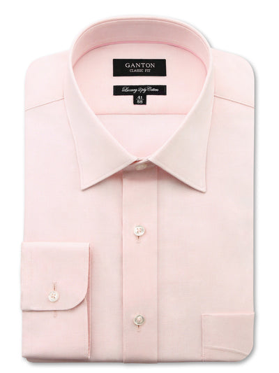 Pink Oxford Shirt with a spread collar, pocket and button cuff.