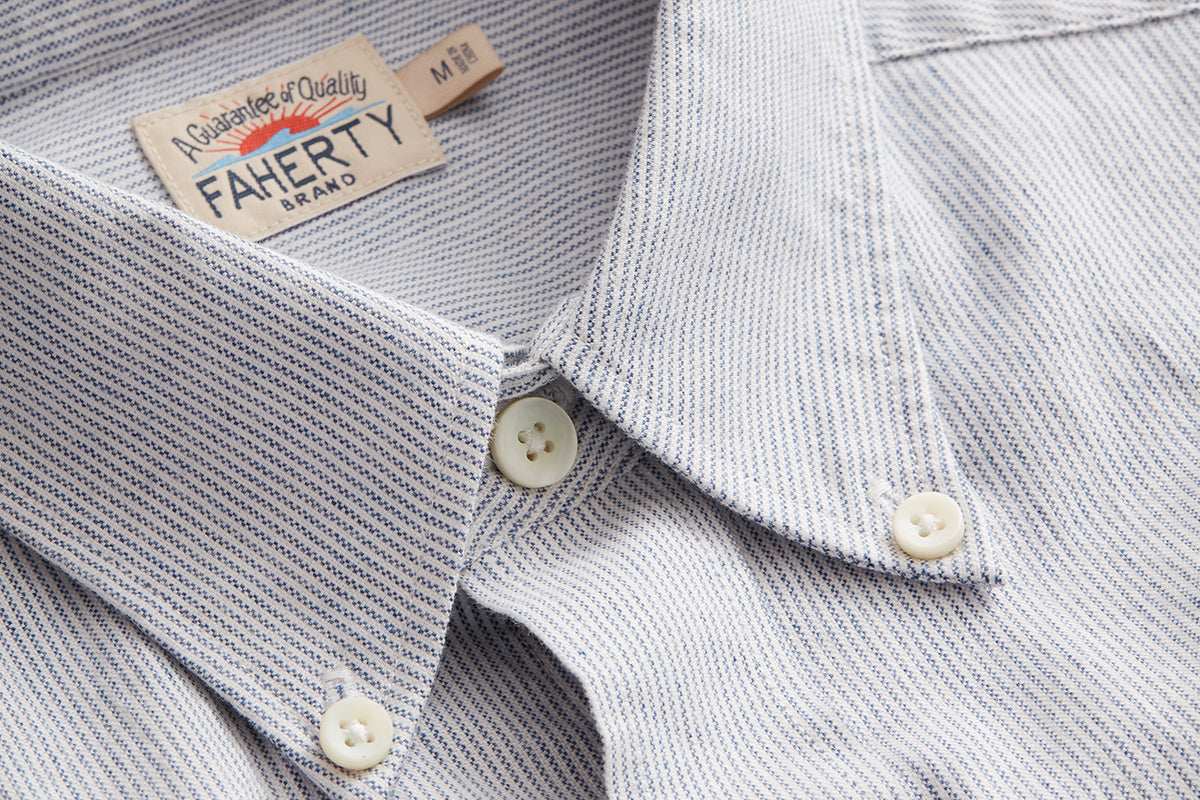 A closeup of an oxford shirt with a button-down collar.