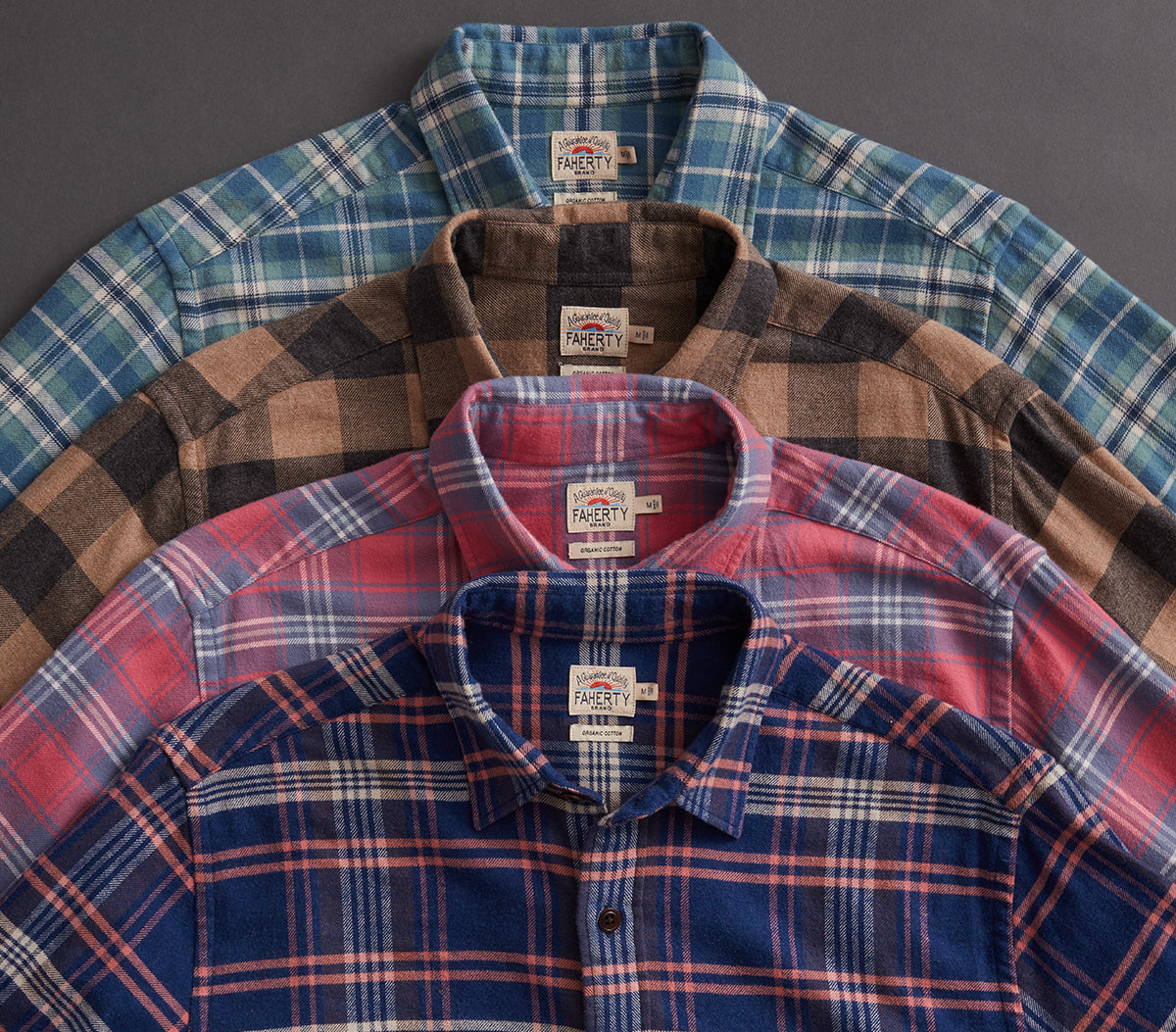 Four flannel shirts stacked on top of each other.