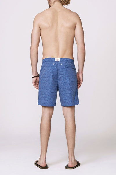 men's blue and navy patterned swimsuit back view