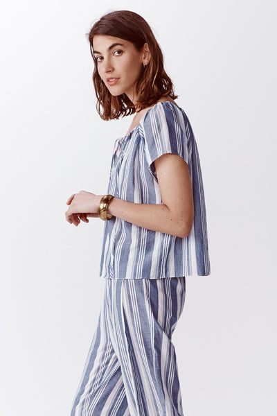 blue and white stripe peasant top side view