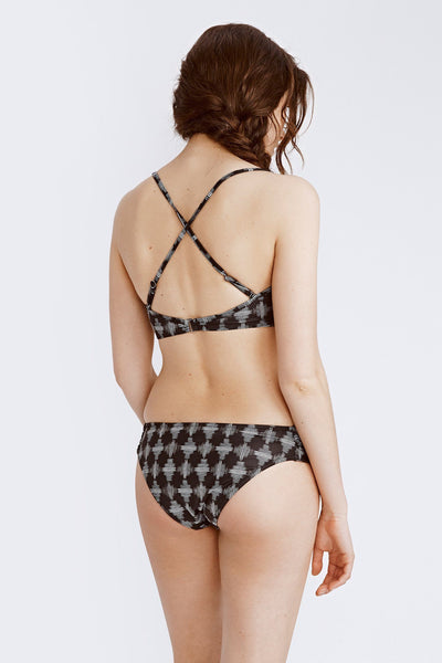 black and white printed swimsuit top back view