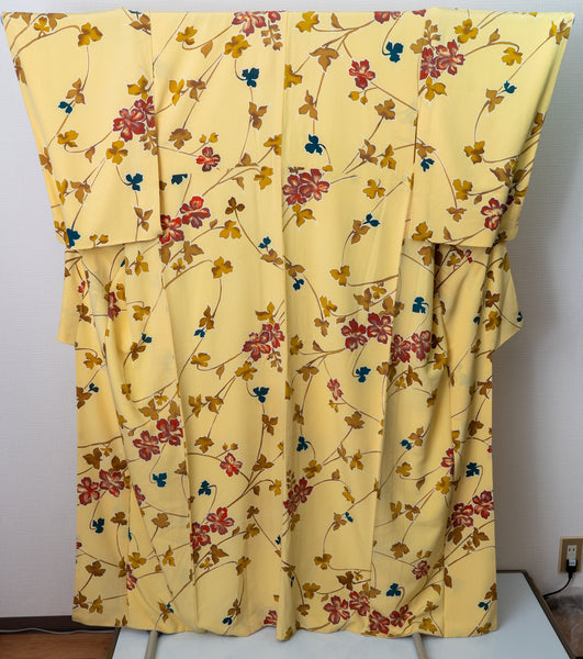 Floral Pastel Yellow Kimono - Repeating Pattern of Red Flowers with Blue and Yellow Leaves and Stems
