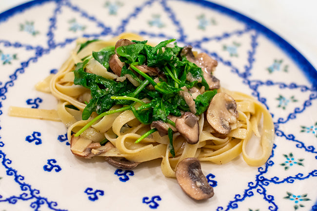 Fettuccine Pasta with Arugula and Mushrooms Plated